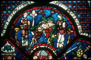 The priest and the Levite pass by the wounded man in this scene from the Chartes window. In the Bourges and Sens windows, this scene is surrounded by image of Moses, showing that the priest and Levite represent the law and the prophets of the Old Testament.