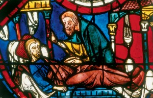 As shown in the Chartres window, early commentators believed the Samaritan stayed with the traveler through the night in the inn (note the burning lamp behind the Samaritan). That the Samaritan represented Jesus to early Christians is evident in the Bourges and Sens windows, which associate the rescue by the Samaritan with scenes from the suffering and resurrection of the Savior.
