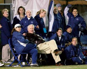 President Bateman with the BYU women's soccer team at a BYU soccer game
