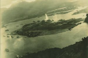 An archival aerial photo of Pearl Harbor being bombed on December 7, 1941