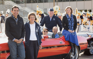 Winners of Alumni Achievement Awards, (from left) Art Rascon, Sandra Mangum, Craig Meyers (seated), David Harris, Nathan Sheets (seated), and Hannah Smith enjoy celebrity status in the 2013 Homecoming parade.