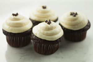 A photo of The Sweet Tooth Fairy's Black and White cupcakes