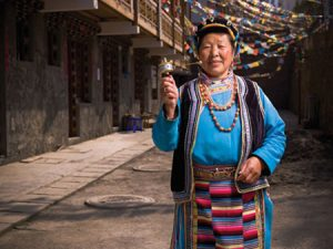 "As they traveled, the BYU group photographed colorfully dressed ethnic minorities, including the Miao, Shuang, Dong, and Yao people. Shad Hopkins was inspired by the people living in the small villages they visited. ""I felt so lucky to see how they live and meet them. I thought that they had so little and lived such a hard life. But these people were happy."" Photo by Shad Hopkins."