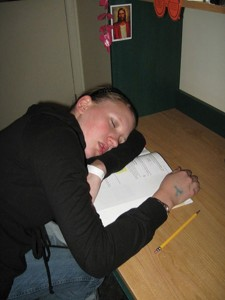Laura Larsen falls asleep while studying for classes.