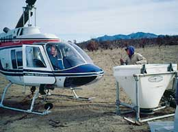 Bruce Roundy and helicopter