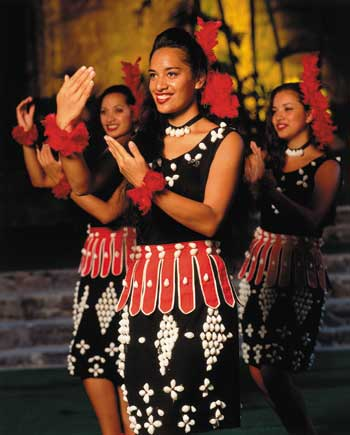 Student dancers Jennifer Niu, Vao Paongo, and Larie Langi represent Tonga in the PCC's night show.