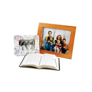 picture frame of friends, picture frame of family members, and opened scriptures