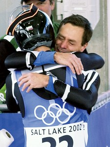 Werner Hoeger shares an emotional moment with his son Christopher after both completed their best luge runs ever.