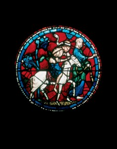 A Chartes, France, cathedral window depicts the good Samaritan leading the wounded traveler to an inn.