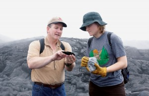 Professor Keith discusses a rock sample with Stpephanie E. Ashley, '05. Students collected samples from the lava fields as part of keith's research aimed at understanding the formation of copper, silver, and gold deposits.