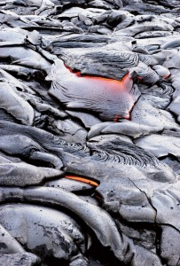 The unusual landscape and active lava flows created by Mount Kilauea in Hawaii Volcanoes National Park make the area a geologist's paradise. BYU geology professor Jeffrey D. Keith, '77, knows th land well and brings students here to study volcanic processes as they happen.