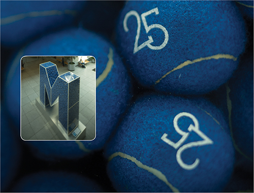 M is for service blue tennis ball