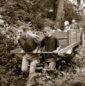 Family pulling a handcart