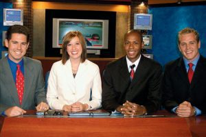 Robert Roxburgh, Andrea Candrian, Othelle Richards, and Brian Carlson compete for the news, representing three TV stations in the same market, but are friends off the set.