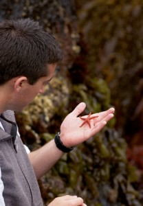 A student holds a star fish