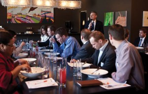 Chris Feinauer (BS '80), sales manager for U.S. Bank's northwest region, speaks to recent graduates at a networking luncheon.