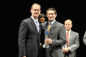 BYU athletic director Tom Holmoe (BS '83) and Steve Young (BA '84)