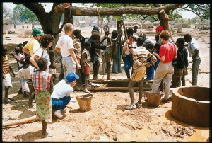 Members of the Ouelessebougou-Utah Alliance (OUA) work with villagers to dig a well in Sirimambougou, Mali, in 1989. Since 1997 a BYU research has been studying the OUA to see what makes NGOs succeed or fail.