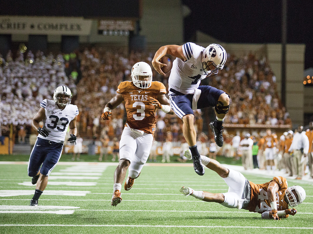 Taysom Hill leaps defender