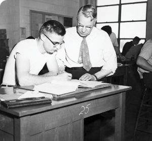 William Snell, here with a drafting student in the 1940s, worked as an industrial arts professor at BYU for nearly 50 years. The Industrial Education Building, which opened in 1960, was named for him. Photo courtesy L. Tom Perry Special Collections UAP 2 F-225