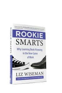 "Liz Wiseman's book Rookie Smarts. It has two different shoes on the cover: one converse and one work shoe. On the cover beneath the title it reads, ""Why Learning Beats Knowing in the New Game of Work."""
