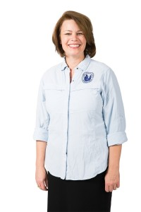 Sharon L. Eubank is wearing her Humanitarian Services shirt and smiling.