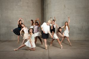 BYU Theatre Ballet dancers posing in dance moves for a photoshoot.
