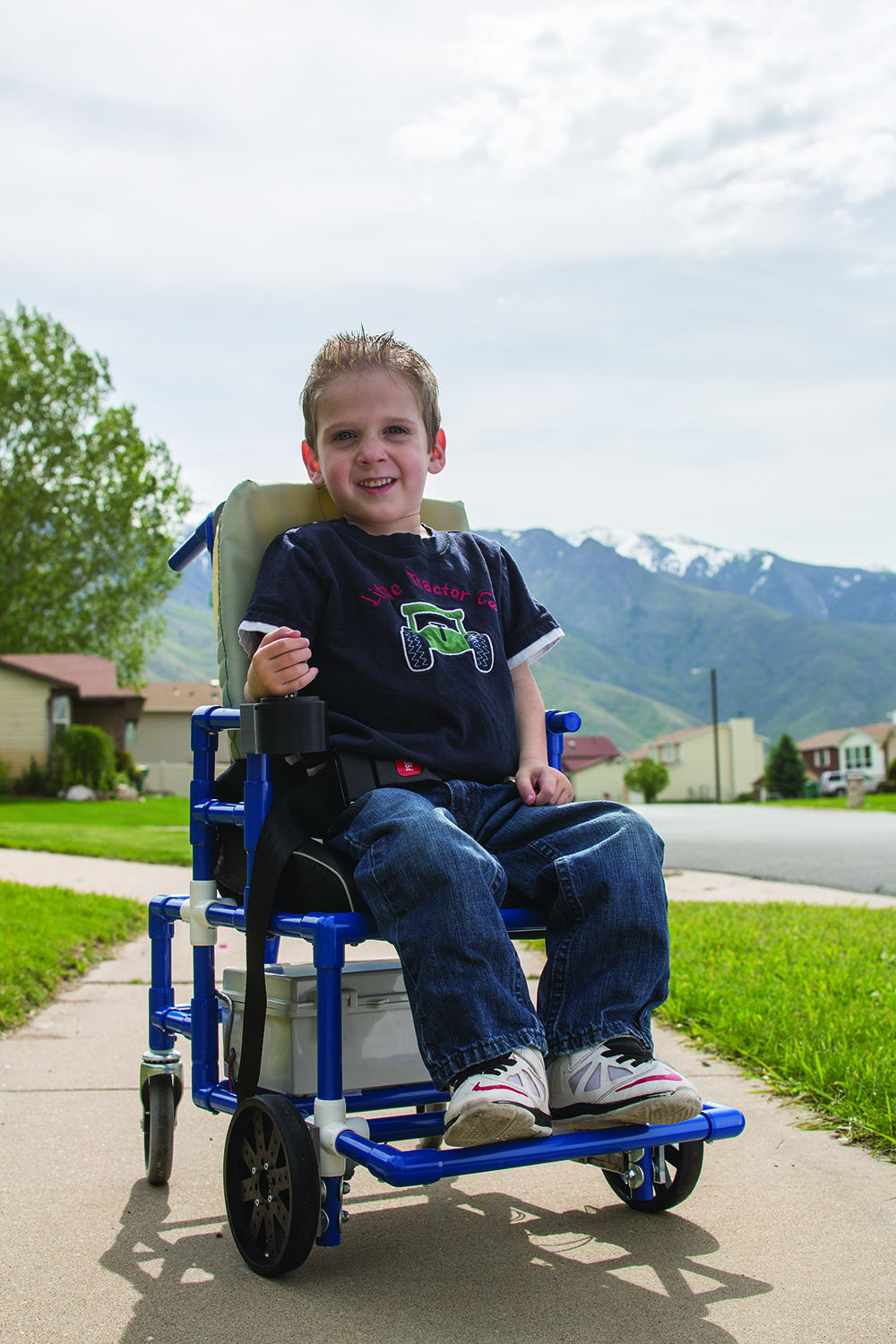 Tanner Jensen, age 4, enjoys his motorized wheelchair designed by BYU engineers