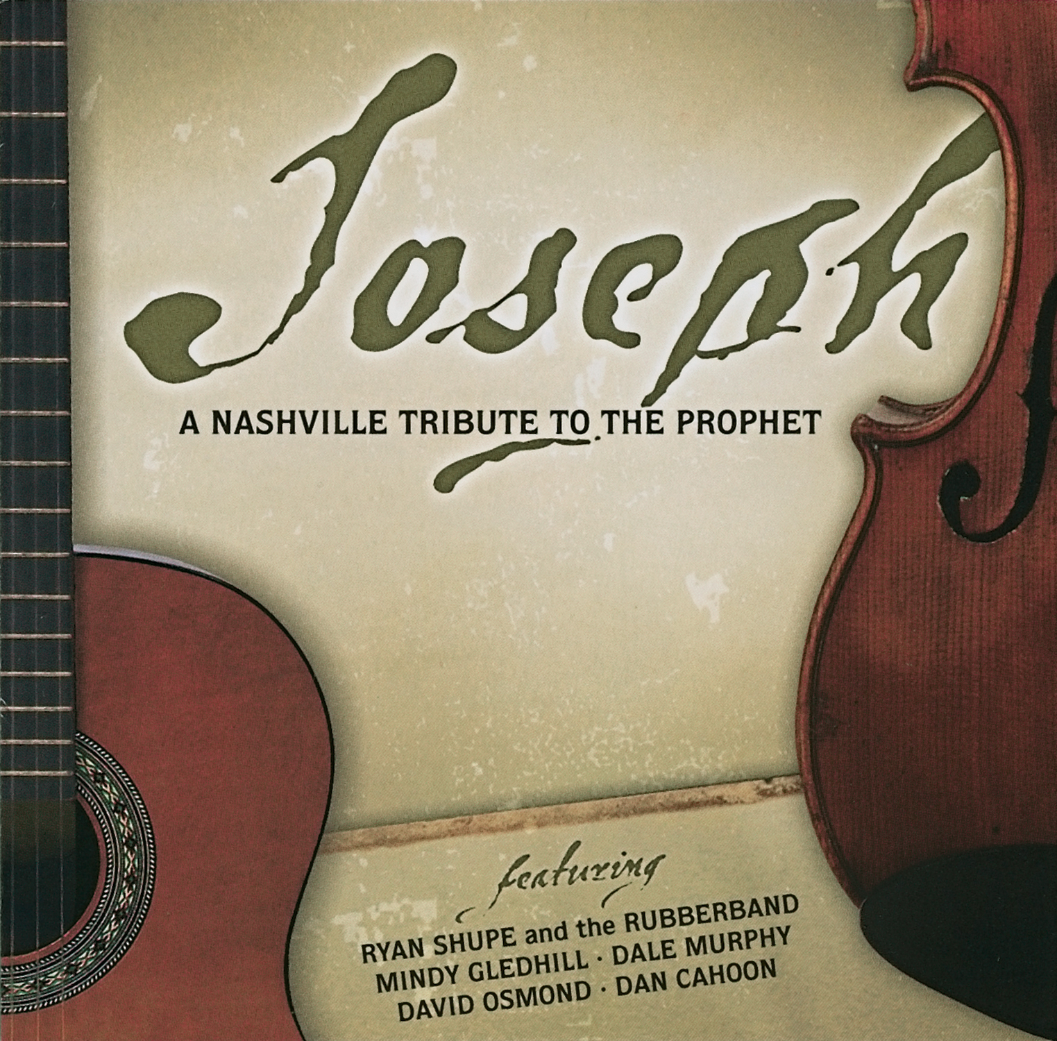 A CD cover titled Joseph with part of a guitar and a violin showing.