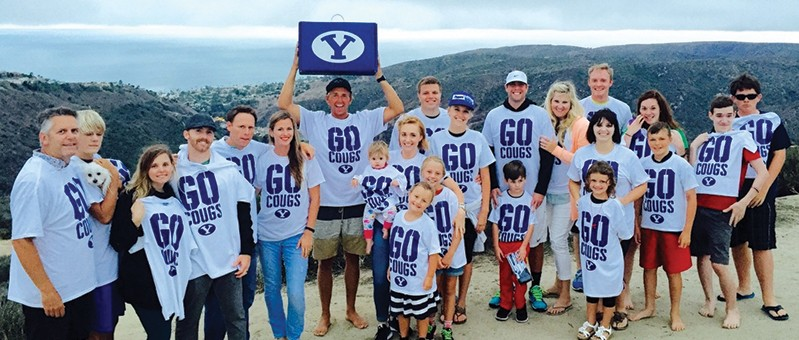 Photo of BYU fans after winning a BYU50 box.