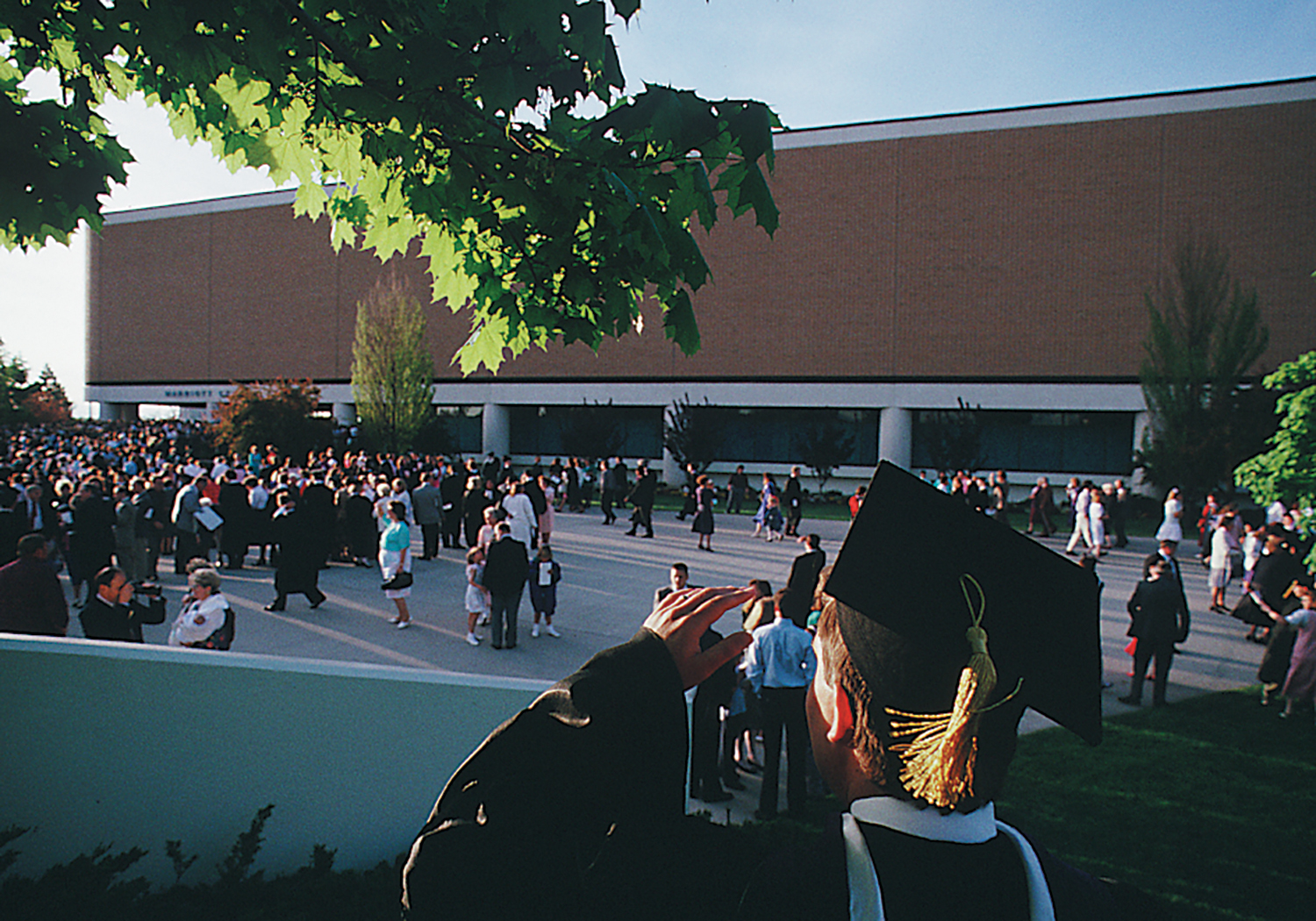 Graduates and families gathered outside of the Marriott Center.