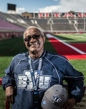 BYU super fan Gilbert WIlliams stands out at Utah's football stadium.