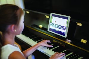 A girl practices the piano.