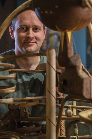 Karl Hale pictured with one of his wooden kinetic sculptures.