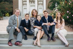 Alumni president Amy Fennegan and her husband, Garth, sit with their children Sam, Boone, Cade, and Reaves.