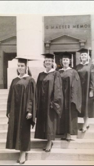 JJoan Davenport, Betty Moody, Sharon Senecal, and Dorene Sheldon wear their graduation robes in front of the Maeser Building in 1958. Photo courtesy of Betty Moody.