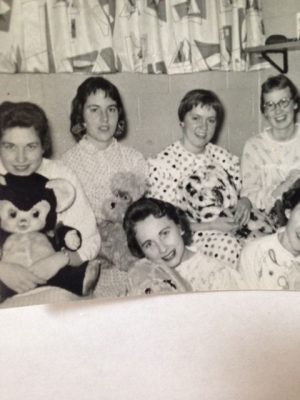 Kay Hansen, Joan Davenport, Dorene Sheldon, Betty Moody, and Sharon Senecal (bottom) pose with teddy bears in their apartment. Photo courtesy of Betty Moody.