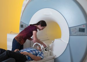 A person being prepared to go into an MRI machine