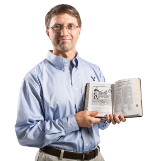 Picture of Kerry M. Muhlestein holding open the scriptures to the Book of Abraham and Facsimile 1.