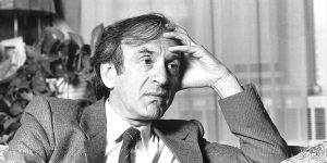 Elie Wiesel, pictured sitting on a couch, delivered this forum at BYU in 1985.