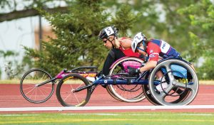 two people in wheelchairs on the track
