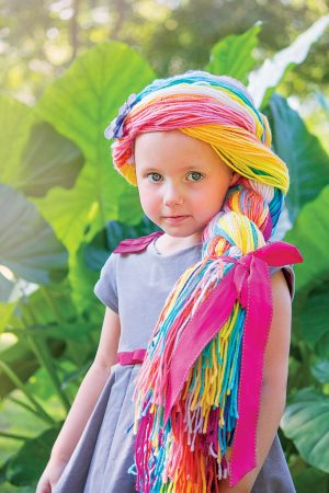 little girl with yarn wig