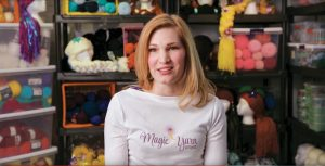 Holly Christensen surrounded by yarn