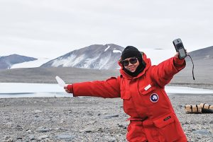 Summer Xue in a red coat in Antartica