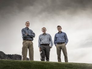 BYU professors Dennis Eggett, Lawrence Rees, and Mark Beecher pose under a gray sky.