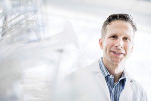 John Price in white lab coat