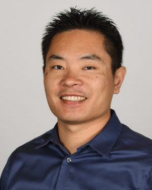 A headshot photograph of Jia Jiang