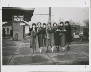 seven female BYU students dressed in long coats and hats