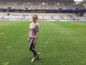 Mallory Stack poses on the field of the Real Oviedo soccer stadium