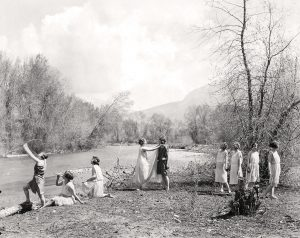 Women in a 1923 BYU women's physical education class perfrom the dance drama Aphrodite and Adonis on the banks of the Provo River.